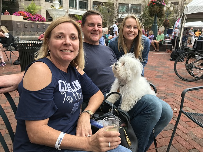 The Barney family of McLean, Kelley, James and daughter Isabel, enjoy family time together at Flavors of Fall produced by the Greater Reston Chamber of Commerce Saturday, Oct. 6.