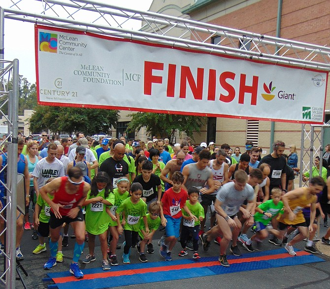 The starting line for the 10th Annual McLean 5K Run, which had 500 runners and took place on Saturday, Oct. 6, 2018, at the McLean Square Shopping Center in McLean.