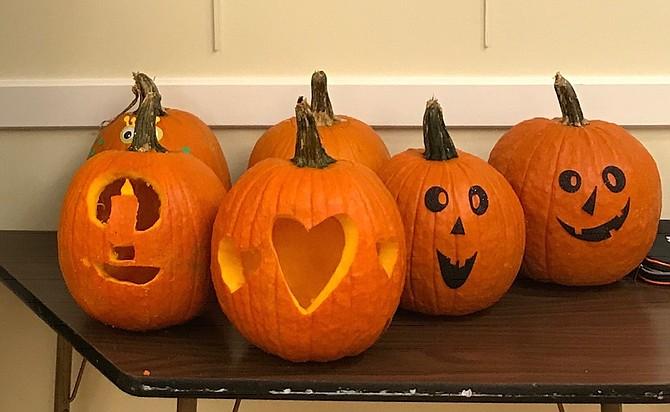 Front porch-ready Halloween pumpkins.