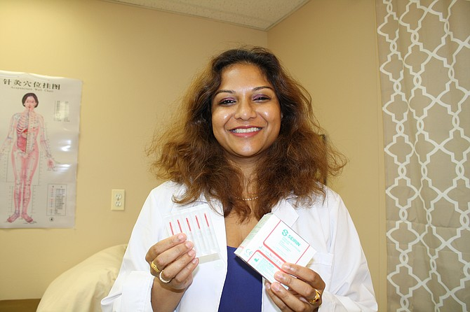It's needles and meditation for Anita Tadavarthy at Empiracal Grace in Springfield.