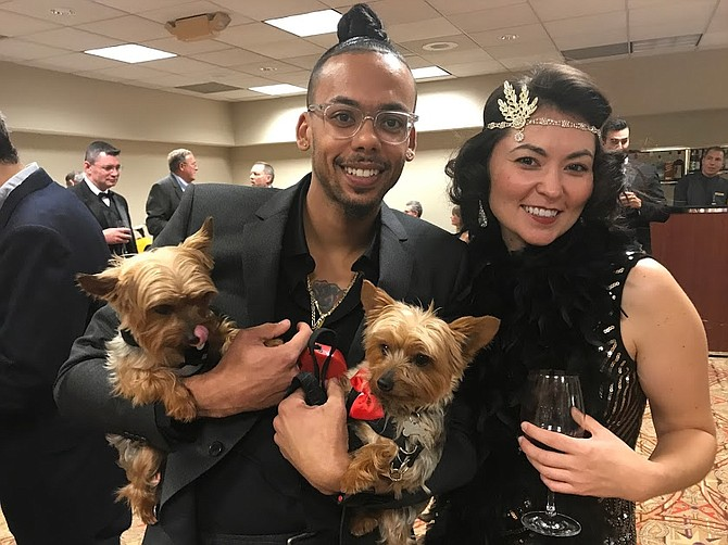 Nyke and Milo ride in the arms of Louie Sweetenberg, chatting with Cassandra Overking at the MCPAW gala at the William F. Bolger Center in Potomac. All of the dogs in attendance were beautifully turned out and brought even more joy to the occasion.