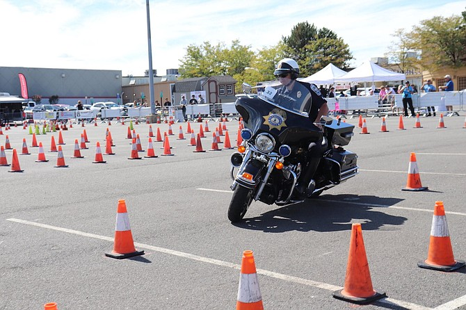 Sgt. Bobby Galpin of the Town of Herndon Police Department expertly weaves his bike through a tight course of orange cones at the 40th Annual Mid-Atlantic Police Motorcycle Rodeo. Galpin placed first in the Timed Cone Course beating out 100 other officers.