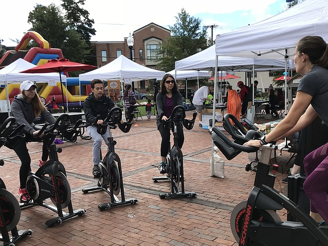 At the second Annual Family Fitness & Fun FEST, visitors hop on bikes provided by New Trail Cycling Studio, Reston and set off on a workout to the beat of music recharging toward a healthier way of life.