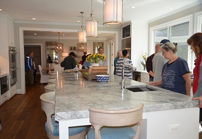Now that's a kitchen! A wall of windows adds spectacular natural light to the Xeller home, massively remodeled for this family of seven, who can enjoy gatherings of family and friends at this amazing kitchen island. A new downstairs master suite gives the adults their own retreat, as well.