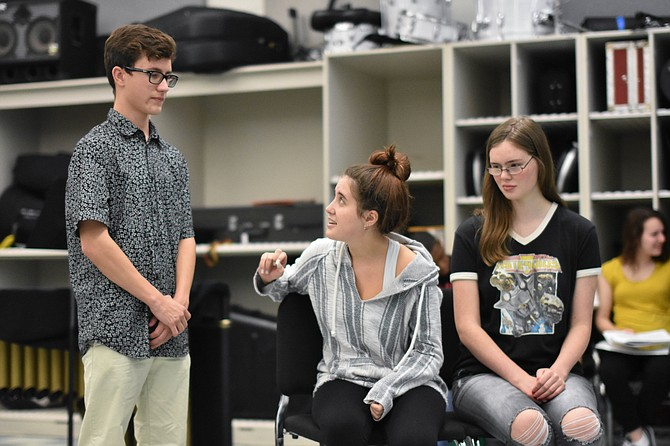 "Andrew Comlish plays Markley, Lyndsey Lawrence plays Grace Fryer, and Kathleen McNerney plays Mrs. Fryer in Bishop Ireton's ""Radium Girls."""