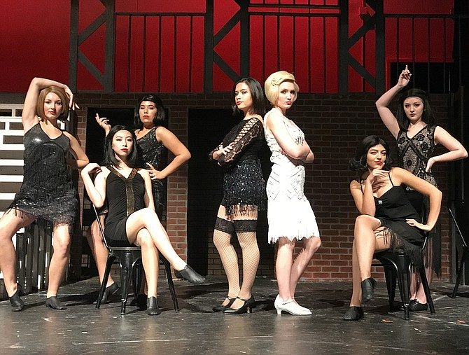 "Playing the ""Merry Murderesses"" are (from left) Haley Herman, Adrian Gao, Serena Satouri, Lauren Spiers (Roxie), Elise McCue (Velma), Jenna Antonacci and Kylie Downie."
