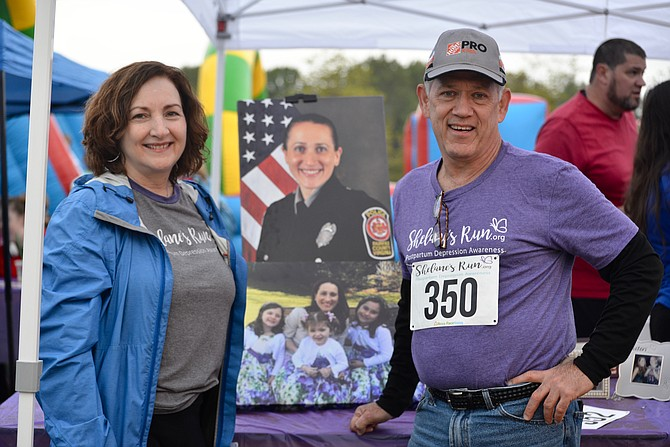 "Joanne and Steve Bryant, the parents of Shelane Bryant Gaydos, pose with photos of their daughter and her children at the 3rd Annual ""Shelane's Run"" charity race. Shelane died of suicide while suffering from maternal mental health issues and her family will ""honor her memory and help others to avoid that tragedy."""