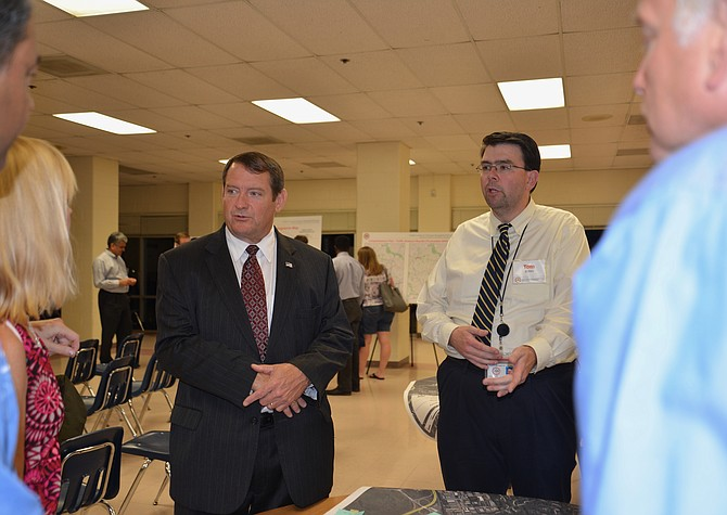 Supervisor Pat Herrity (R-Springfield) and Thomas Burke, FCDOT's Project Manager for the Fairfax County and Franconia-Springfield Parkways study, talk with meeting attendees after Burke's presentation at Sangster Elementary in Springfield on Oct. 11.