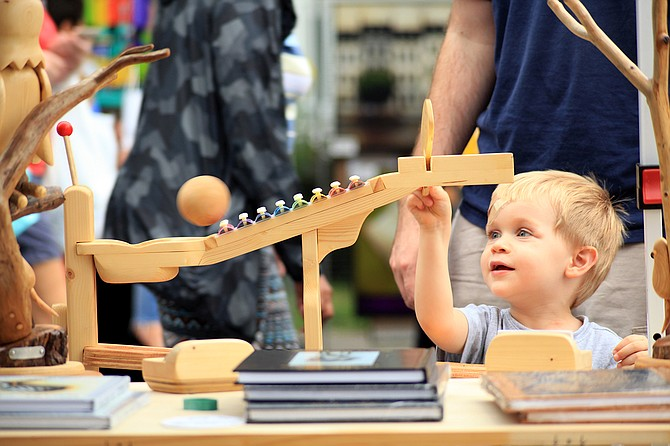 Three-year-old Alex LeVan plays with 3D art by JM Connolly.