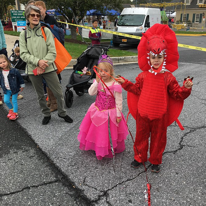 Princess Amelia and Dragon Lukas dressed in costume to watch the Potomac Day Parade on Saturday.