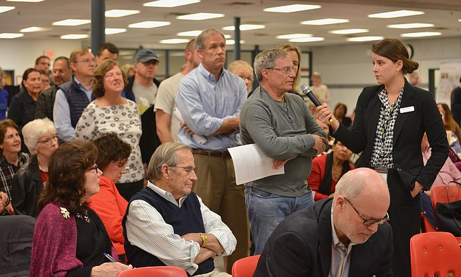 Lining up to have their say: After the VDOT presentation on the pilot program to alleviate local traffic problems by closing the northbound ramp from Georgetown Pike to I-495, more than 60 area residents quickly lined up to ask questions and make comments.