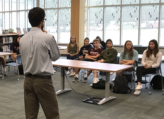 "Forsthoefel leads an AP Psychology class in Langley's library during the day's first breakout session. In a circle, Forsthoefel asked students to share the name of a person for whom they chose to dedicate their ""walk,"" or their day."