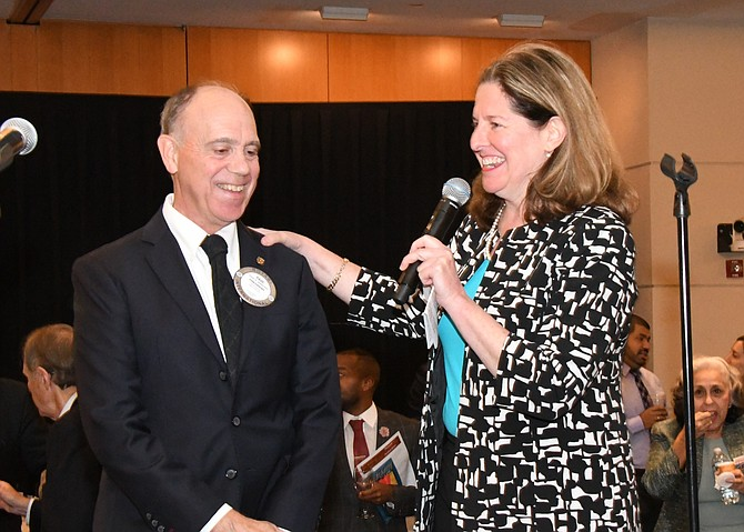 Mayor Allison Silberberg, right, congratulates Rotary Club President Paul Anderson on the success of Taste For Giving. The event raised $70,000 for local charities.