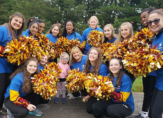 Bishop Ireton Varsity Cheerleaders assist at the annual Buddy Walk for the Down Syndrome Association of Northern Virginia.
