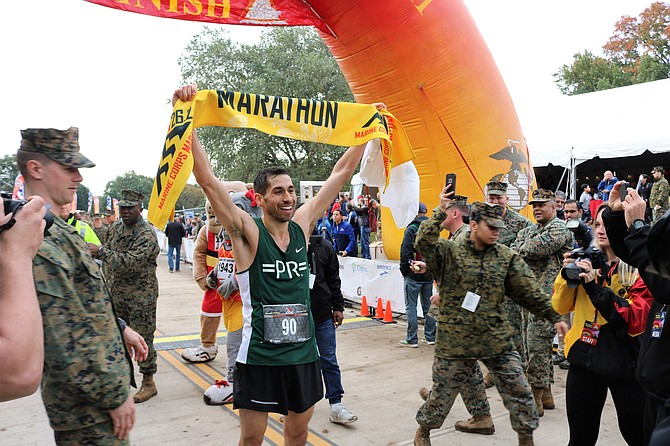 D.C. resident Jeffrey Stein, 32, celebrates after winning the 2018 Marine Corps Marathon Oct. 28 in Arlington. Stein finished the 26.2-mile course in 2:22:49.