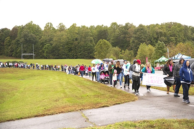 Buddy Walk teams make their way around Signal Hill Park in Manassas.