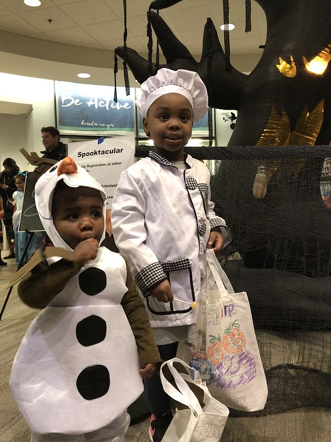 A haunted tree with glowing eyes is no threat to the brave of heart as Omari Barbour, 1 1/2 of Herndon, and his sister Naima, 4, get up close to the ghoulish tree at Spooktacular produced by Herndon Parks and Recreation.