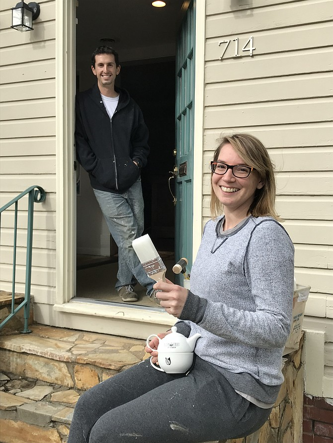 Owner of Elden Street Tea Shop, Rachel Eisenfeld, is ready for a pot of tea before she and Michael Rozner begin painting the interior of her new shop located on a historic street in downtown Herndon.