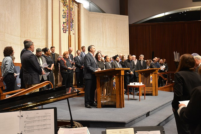 "Unity in Faith. During the service for the victims of the Temple of Life and the Kroger store shootings, the hosts at the Temple Rodef Shalom in Falls Church invited the representatives of the many faiths who had gathered in unity to come forward and ""stand as one."""