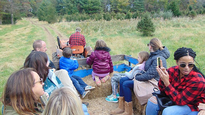 Larry Krop, owner of Krop's Crops, leads the hayride through his 22-acre property in Great Falls.