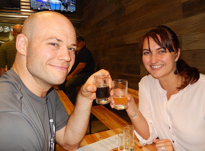 Fairfax residents Jeff and Heather Waye enjoy their beer flights.