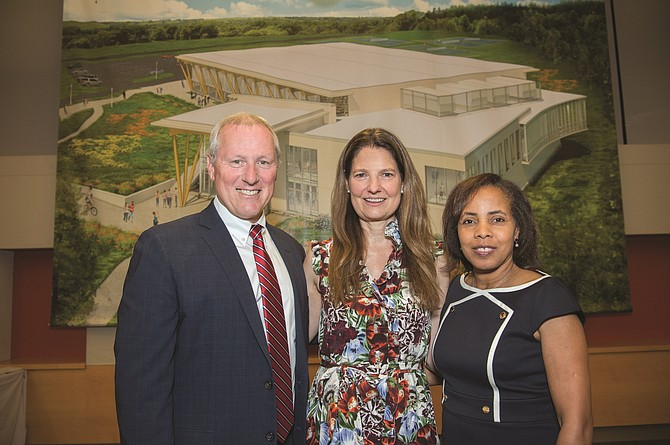 Head of School John Kowalik, Trustee Dr. Abigail Spangler, and Board of Trustees Chair Dr. Marjorie Brennan with an architect's rendering of The Potomac School's Center for Athletics and Community.
