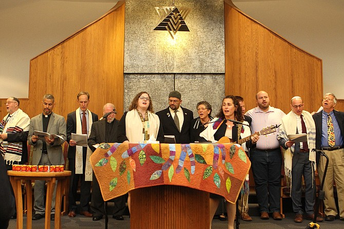 Visiting interfaith partners and community leaders stand in unity with Rabbi Michael Holzman and the congregation of Northern Virginia Hebrew Congregation during the first Shabbat after the Pittsburgh shooting when a gunman opened fire leaving 11 dead and six injured.