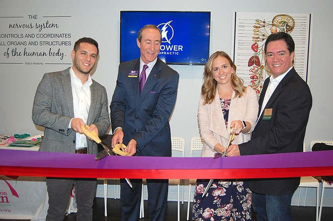Empower Chiropractic holds double ribbon cutting ceremony with Reston and Tysons Chambers of Commerce. From left: Dr. Evan Lichtenauer, co-founder Empower Chiropractic; Marc Ingrao, president and CEO, Reston Chamber of Commerce; Dr. Callan Lichtenauer, co-founder Empower Chiropractic; and Chris Tomseth, vice president, marketing, Tysons Regional Chamber of Commerce.