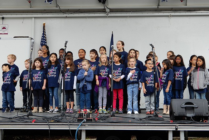The Fairfax Choral Society Youth Choir sings the National Anthem during Centreville Day's opening ceremonies.
