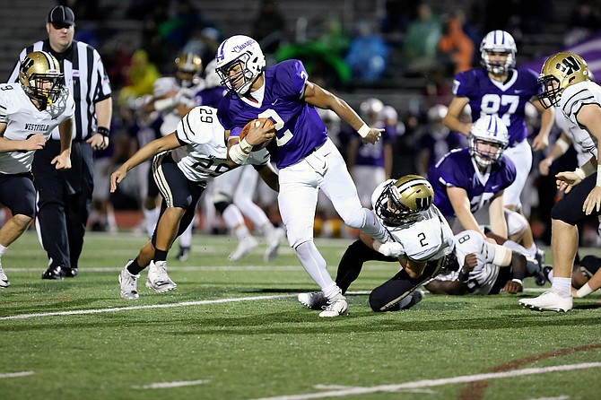Chantilly's Dylan Sparks #2 tries to fight through the tackle of Westfield's Taylor Morin #2.