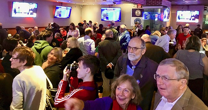 Local Democrats watch Tuesday's election results come in at Glory Days Grill.