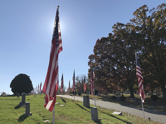 On Veterans Day 2018, casket flags fly in the breeze at Chestnut Grove Cemetery in Herndon.  The American Legion Wayne M. Kidwell Post #184 Herndon//Reston raises more than 100 casket flags every Veterans Day and Memorial Day in honor of fallen Herndon veterans.