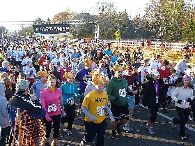 And they're off! Runners begin the 2016 Virginia Run Turkey Trot.
