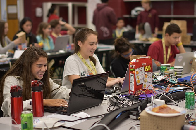 Students work on their coding during a two-day Hackathon at Bishop Ireton High School. The second annual event drew more than 150 middle and high schoolers.