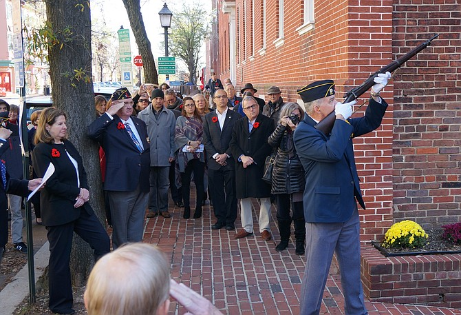 American Legion Post 24 officer Mike Mixon fires a salute during the Armistice commemoration ceremony Nov. 11 at Post 24 in Old Town.