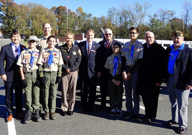 Participants gather for a group photo after Sunday's Veterans Day ceremony at American Legion Post 177.