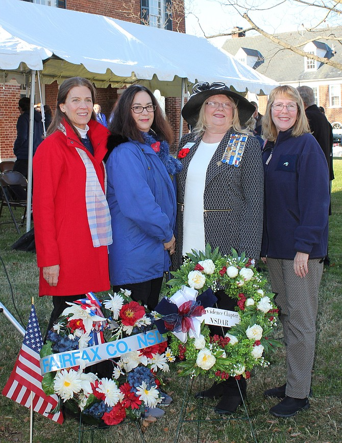 From left, Lecia Dorfler, Rosemary Smith, Regent Cathy Sampson and Donna Hoenscheid, members of the Providence Chapter of the National Society of the Daughters of the American Revolution (NSDAR), participate in the wreath-laying ceremony, honoring those who died in WW1.