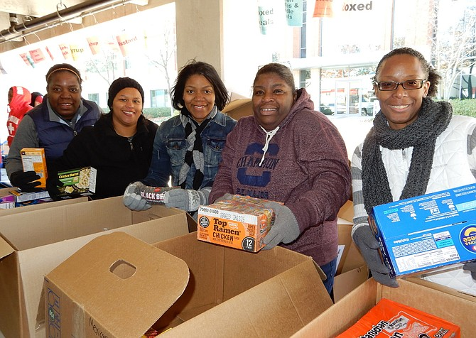 Sorting the donated food are members of The Church of the Blessed Trinity in Centreville's Gate Post Estates community. From left are Karen Spottswood, Crystal Perkins, Rochelle Brown, Cheron Sloan and Valerie Grayson.