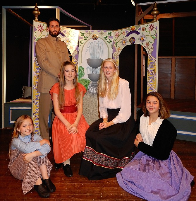 "Rehearsing a scene from City of Fairfax Theatre Co.'s ""The Little Princess"" are: (in back) Brandon Moon and (seated, from left) Gigi Moon, Alyssa Kiffer, Martha Zimmerman and Sydney Krug."