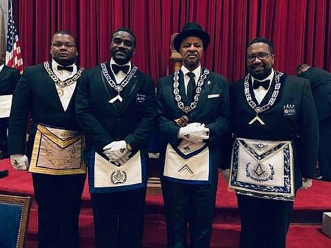 Universal Lodge No. 1 Worshipful Master McArthur Myers, second from right, poses with other Brethren Oct. 24 as the first Prince Hall Masonic Lodge held a meeting at the George Washington National Masonic Memorial.