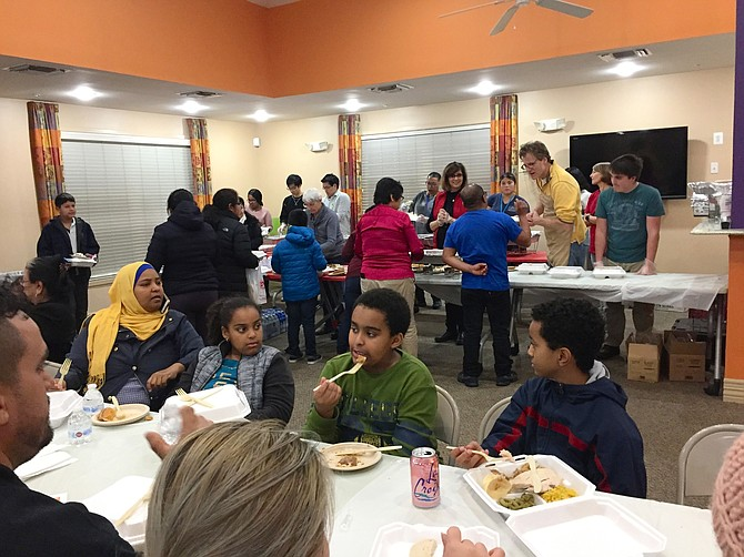 Arlington Housing Corporation (AHC) affordable housing residents enjoy Thanksgiving dinner cooked and served by local volunteers.