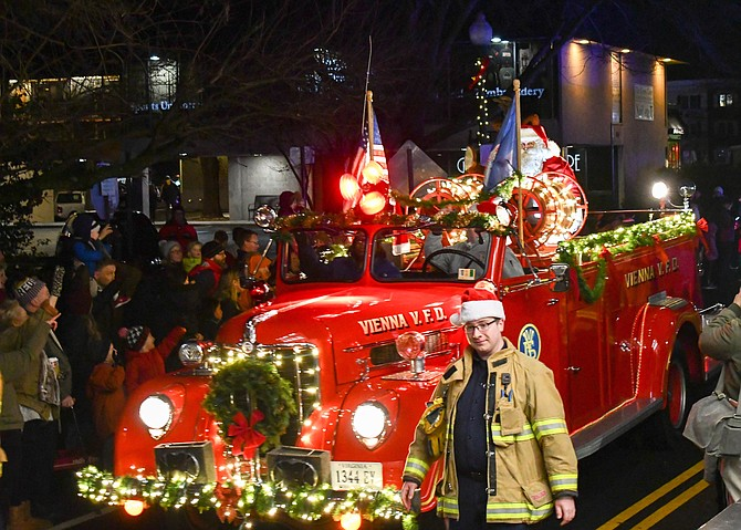 Santa rides on a 1946 Vienna fire truck.