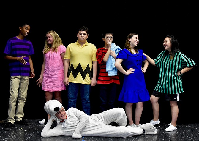 "Dressed as characters from ""Peanuts"" are (standing, from left) Jalin Dew, Anna Moritz, Alan Gutierrez-Urista, Paul Lee, Lauren LeVine and Faith Cho, with Harry Schlatter (on floor) as Snoopy."