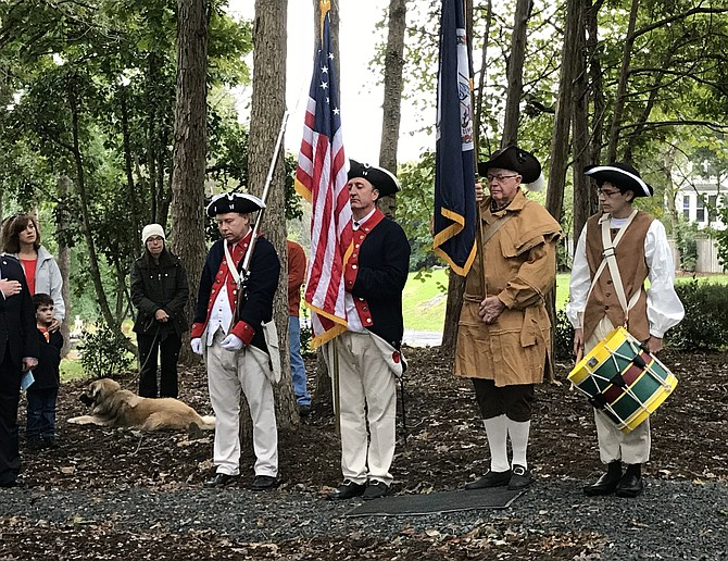 The ceremony opened with the presentation of flags by a four-person color guard from the Fairfax Resolves chapter of the Sons of the American Revolution costumed in 18th century uniforms.