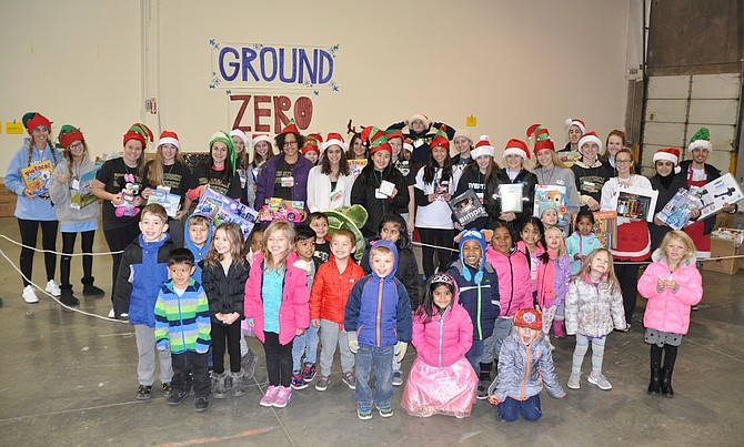"Karen Fiala with her ""Ground Zero"" team and preschool students from one of the six local preschools that help ONC collect toys each year."