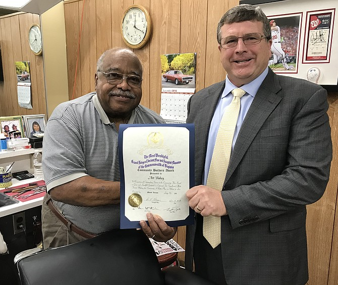 Al Glaeser, Worshipful Master of Mount Vernon Masonic Lodge No. 219, presents the Community Builders Award to Art Blakey of the Hollin Hall Barbershop.