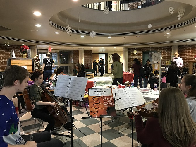 Lydia Goff, violin, Melissa Kramer, violin, Joshua Nielson, viola, and Vivian Olsen, cello perform during the Herndon Fortnightly Library Christmas Winter Holiday Open House.