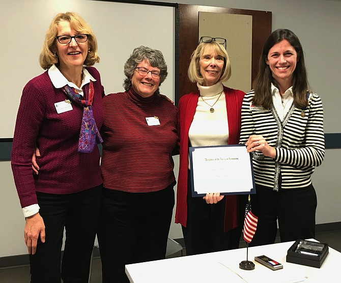 Chapter members presenting Sandra Grimes with the Women in History Award, from left: chapter member Jean Luning-Johnson, Chapter Historian Maureen Jenkins, Sandra Grimes, and Chapter Regent Beth Boswell.