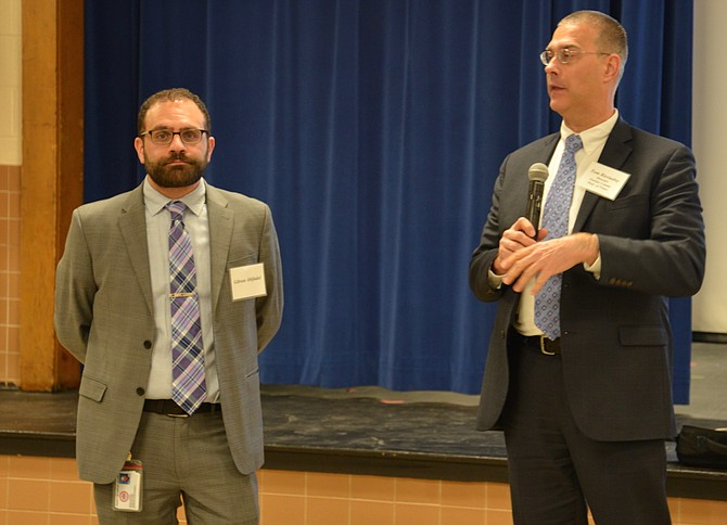 From left: Project manager Gibran Abifadel and Director of Fairfax County Dept. of Transportation Tom Biesiadny present the recommendation A-1 to improve the Balls Hill/Old Dominion intersection to a meeting of residents. The meeting was originally scheduled to take place earlier in the month, but was postponed due to the snow event.