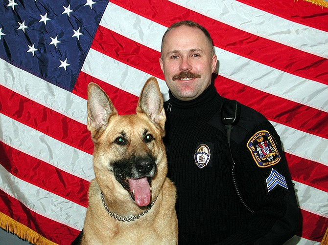 Carl Pardiny as a young K-9 officer with his dog, Doni.